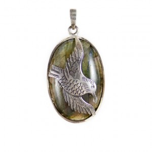 silver oval pendant with carved bird motif