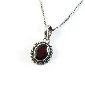 Silver Jewelry: Silver pendant with silver chain and with dark garnet stone